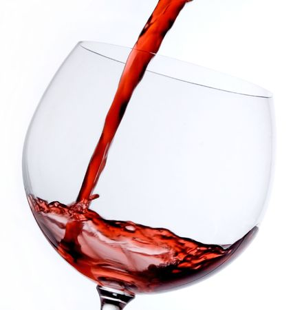 fluent: Red wine being poured in a glass Stock Photo