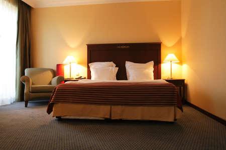 Double bed in bedroom of hotel, Tashkent photo