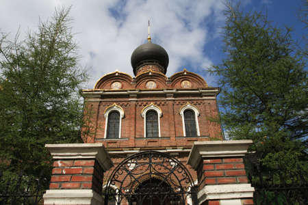 Front of brick church in the summer, Moscow photo