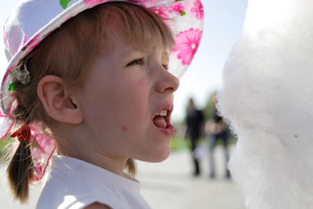 The girl with candyfloss in the summer Stock Photo - 944122