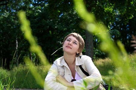 grassy plot: The girl on grassy plot in summer