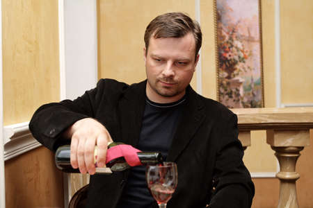 The man pours red wine at restaurant Stock Photo - 1479326