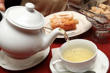 The green tea with pastry and sugar in restaurant photo