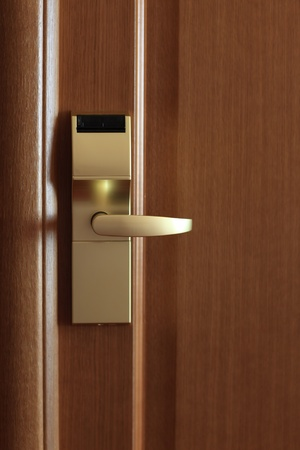 It is golden doorhandle in the hotel photo