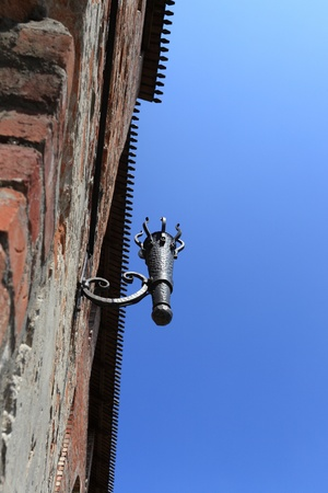 Torch holder on the wall of Kolomna Kremlin in Russia photo