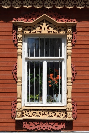 Tipical window of russian wooden house, Kolomna Kremlin, Russia photo