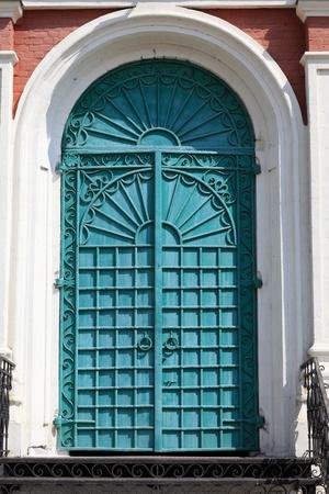 exaltation: Green door of exaltation of the Cross cathedral in Brusensky monastery, Kolomna Kremlin, Russia Stock Photo