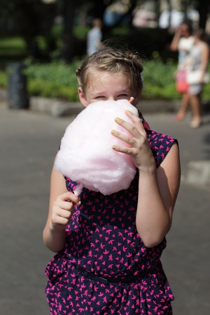 Portrait of kid with cotton candy at the park photo