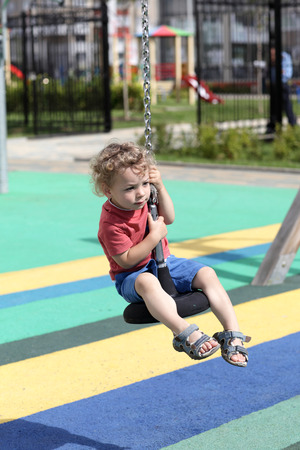 cableway: Boy is playing at cableway at playground Stock Photo