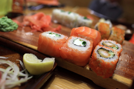 Sushi on a wooden board in a japanese restaurant photo