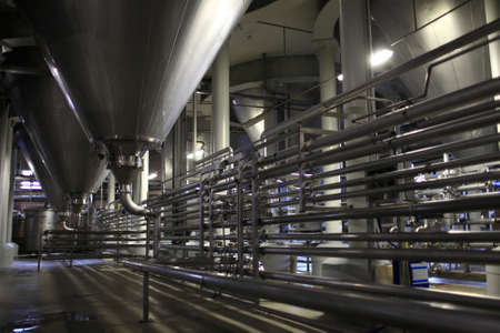 fermenting: Pipes of brewery at a fermentation department Stock Photo
