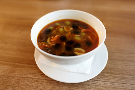 Solyanka is a thick, spicy and sour soup in Russian cuisine photo