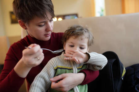 refusing: Son refuses to eat in the cafe