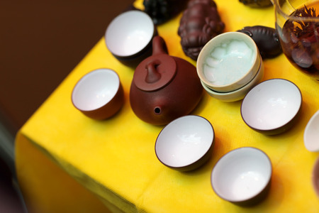 Tea ceremony set on an yellow table photo