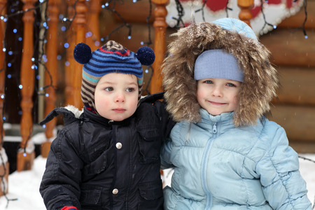 winterwear: Portrait of two brothers in winter park