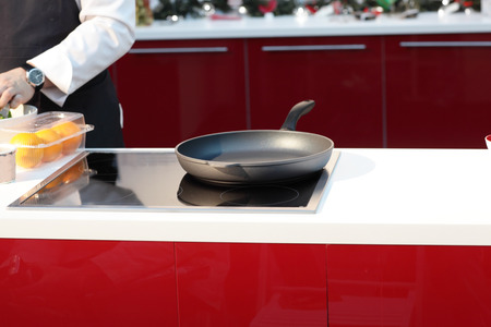 Pan on the stove at red kitchen photo