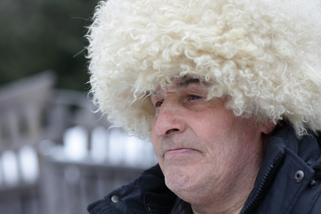 papakha: Portrait of man in caucasian hat outdoor in winter