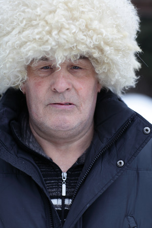 papakha: Portrait of man in papakha outdoor in winter