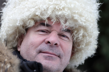 papakha: Portrait of man in white papakha outdoor in winter