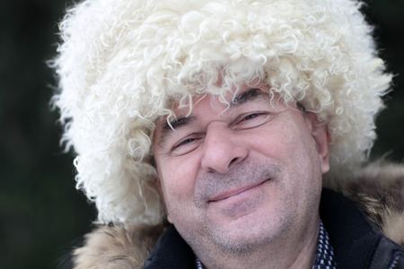 papakha: Portrait of happy man in papakha outdoor in winter