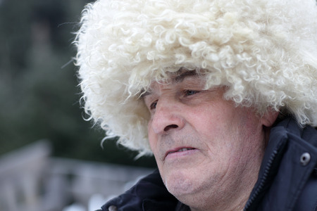 papakha: Portrait of man in white caucasian hat Stock Photo