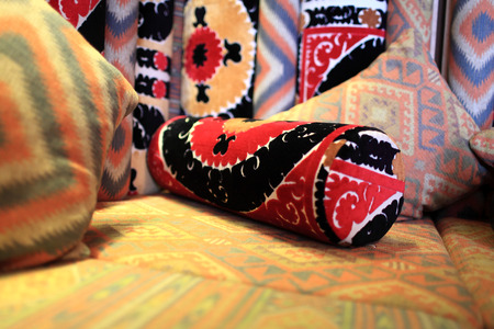uzbek: Cushion on couch in an uzbek restaurant Stock Photo