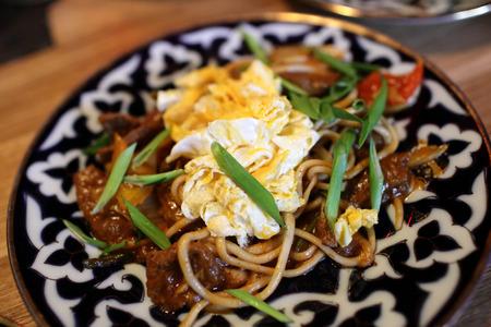 uzbek: Uzbek lamian noodles fried with vegetables and lamb Stock Photo