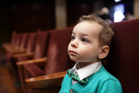 shirt and tie: Kid listening to music on the concert