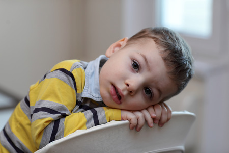 highchair: Portrait of boy at highchair at home
