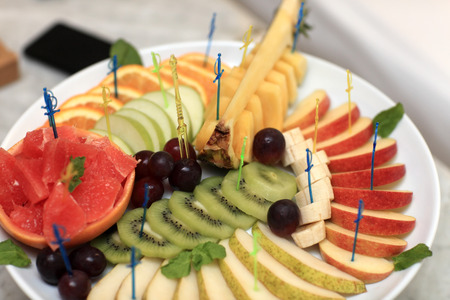 Assorted fruits on a plate in the cafe photo
