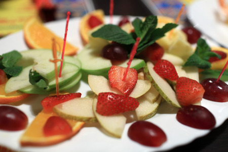 Sliced of various fruits in the cafe photo