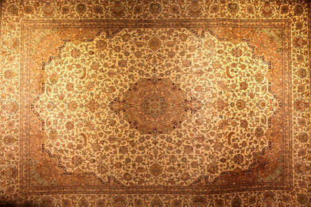 The vintage brown persian carpet as background Stock Photo