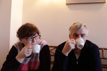 Senior couple has tea in a restaurant photo
