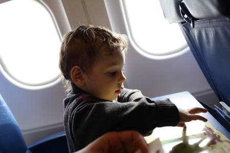 Portrait of a boy on the flight photo