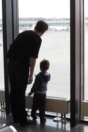 The family waiting airplane at an airport photo