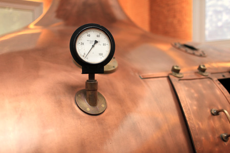 Old thermometer on the tank at the old brewery photo