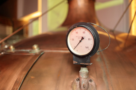 Retro thermometer on the tank at the old brewery photo