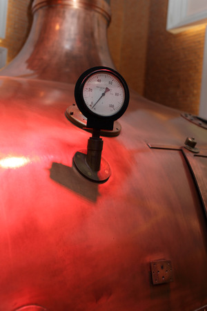 Thermometer on the copper tank at the old brewery photo