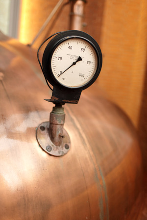 Thermometer on the tank at the old brewery photo