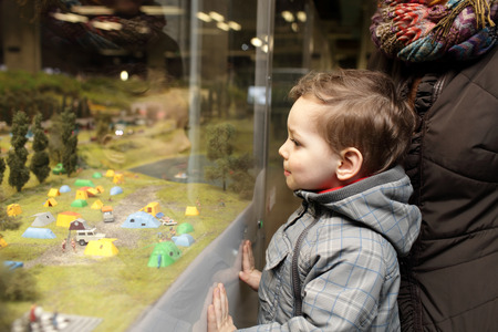 Kid looking at toy camping the indoor playground photo