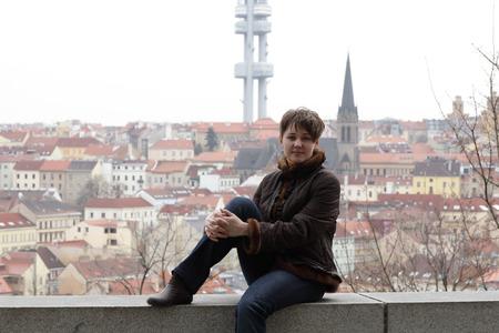 Woman posing on a Prague background at Vitkov hill photo