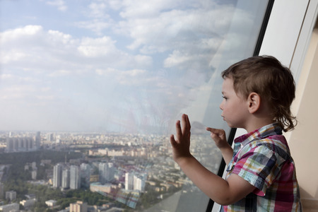 penthouse: The kid looking at Moscow from penthouse