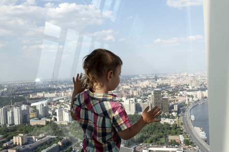The child looking at Moscow from penthouse photo