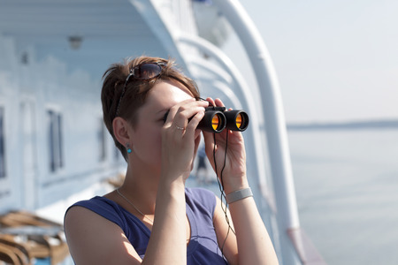 Portrait of a girl with binoculars on the ship photo