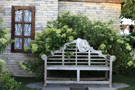 porches: The old wooden bench near a house