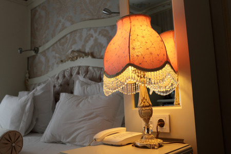 nice accommodations: Lamp on the bedside table in a bedroom