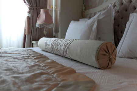 Roller on the double bed in a bedroom photo
