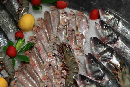 Details fishes on the counter at a market photo