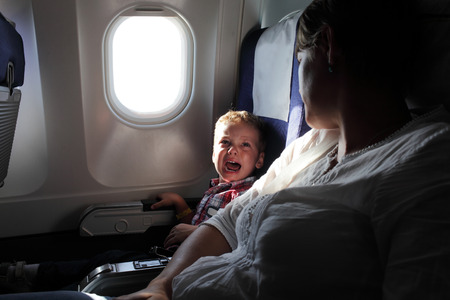 Portrait of the crying boy on the flight