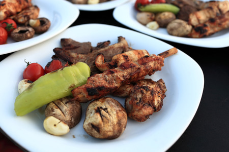 Plate with assorted grilled meat and vegetables in the restaurant photo